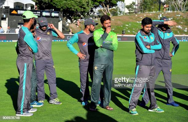 Pakistan players watch New Zealand being presented with the trophy after the 5th oneday international cricket match between New Zealand and Pakistan...