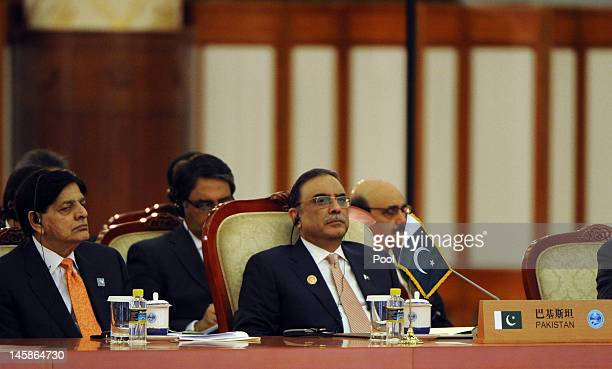 Pakistan President Asif Ali Zardari sits with his delegation during the closing session of the Shanghai Cooperation Organization summit in the Great...