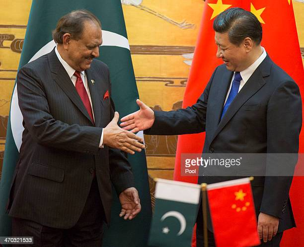Pakistan President Mamnoon Hussain attends a signing ceremony with Chinese President Xi Jinping at the Great Hall of the People on February 19 2014...