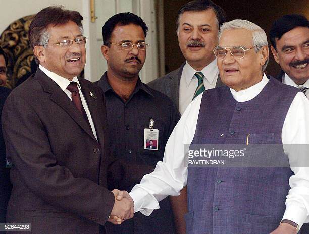 Pakistan President Pervez Musharraf shakes hands with former Indian Prime Minister Atal Behari Vajpayee during a meeting at Vajpayee's residence in...