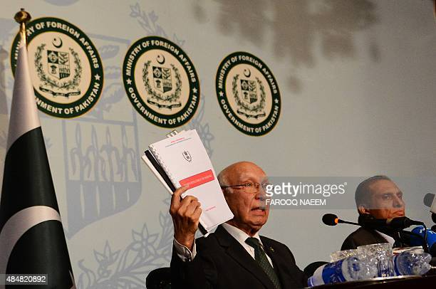 Pakistan Prime Minister Adviser on National Security and Foreign Affairs Sartaj Aziz shows the dossier against raw involvement in promoting terrorism...