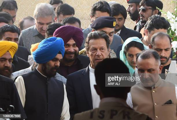 Pakistan Prime Minister Imran Khan and alongside Indian Minister for Food Processing Industries Harsimrat Kaur Badal and India's Punjab cabinet...