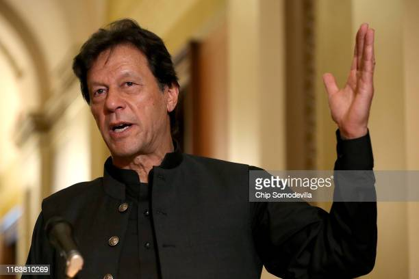 Pakistan Prime Minister Imran Khan makes a brief statement to reporters before a meeting with US House Speaker Nancy Pelosi at the US Capitol July 23...