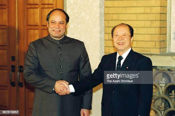 Pakistan Prime Minister Nawaz Sharif and Japanese Prime Minister Kiichi Miyazawa shake hands prior to their meeting at the prime minister's official...