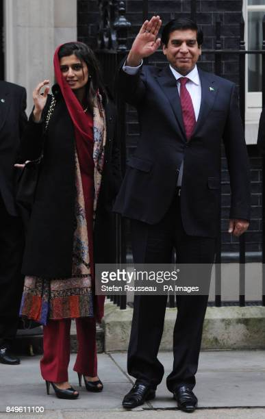 Pakistan Prime Minister Raja Pervaiz Ashraf leaves 10 Downing Street in London with his Foreign Minister Hina Rabbani Khar after meeting with Prime...