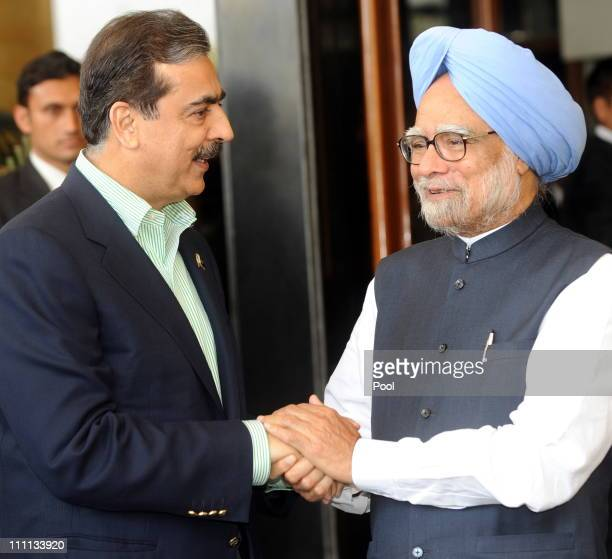 Pakistan Prime Minister Yousuf Raza Gilani shakes hands with Prime Minister Manmohan Singh of India prior to the start of the 2011 ICC World Cup...