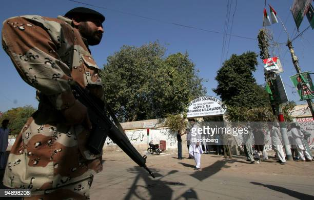 Pakistan ranger security guards stand alert outside of a polling station in Karachi Pakistan on Monday Feb 18 2008 Pakistani voters decide today...