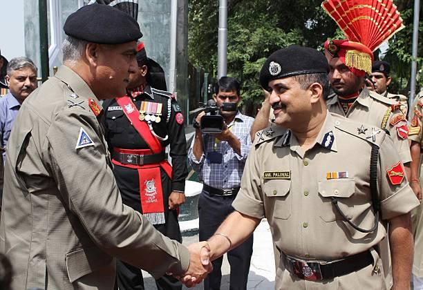 Pakistan Rangers Director General Major General Umar Farooq Burki shakes hand with Indian Border Security Force Inspector General Anil Paliwal at the.