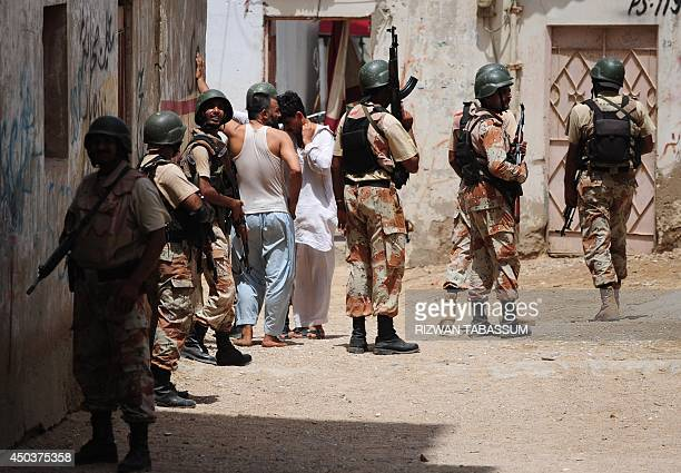 Pakistan rangers hold passersby during a search operation after the firing incident near Karachi airport in Karachi on June 10 2014 The second attack...