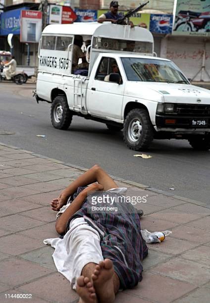 A Pakistan Rangers patrol passes a homeless man asleep on the footpath in Karachi Pakistan on Thursday May 19 2011 Pakistan is set to extend a...