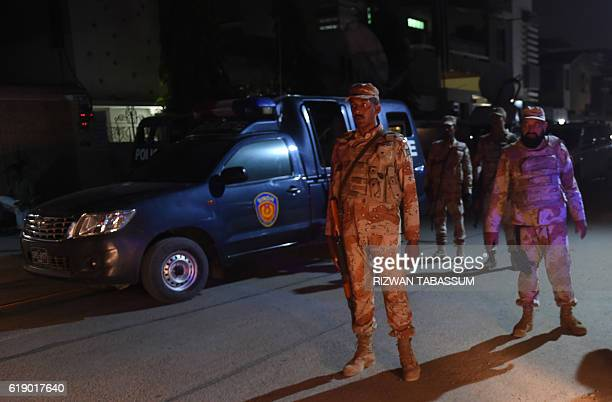 Pakistan Rangers stand guard after the firing incident in Karachi on October 29 2016 Two gunmen on a motorcycle opened fire on a Shiite Muslim...