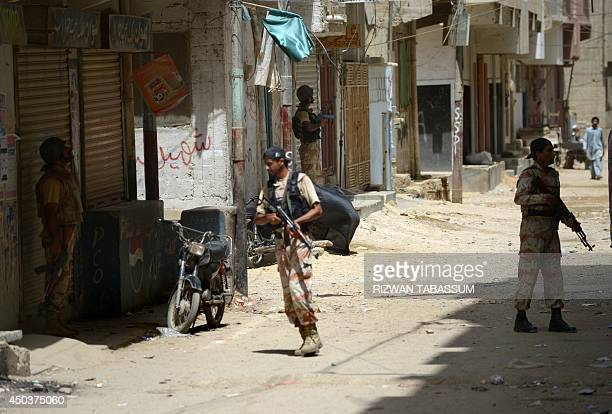 Pakistan rangers take part in a search operation after the firing incident near Karachi airport in Karachi on June 10 2014 The second attack on...