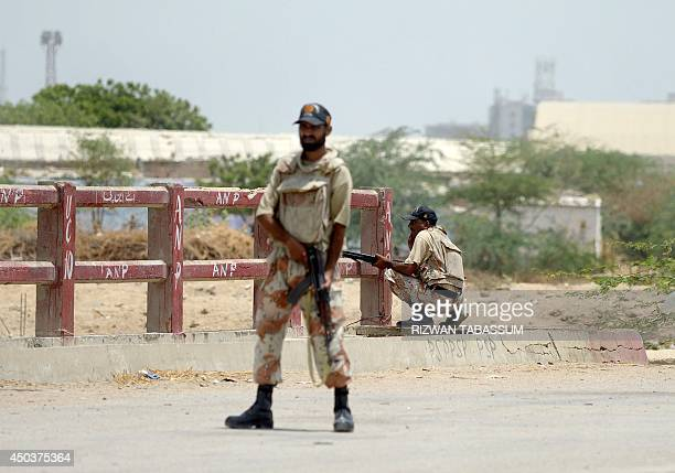 Pakistan rangers take position after the firing incident near Karachi airport in Karachi on June 10 2014 The second attack on Pakistan's Karachi...