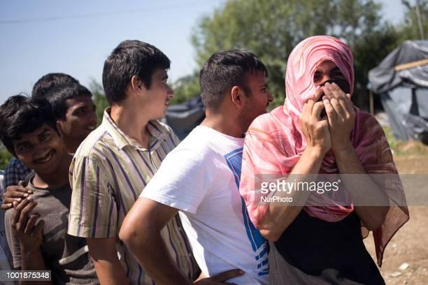 Pakistan refugges eat a dinner in Refugee camp in Velika Kladusa BiH on July 19 2018 Refugee camp in Velika Kladusa located near Bosnia and...