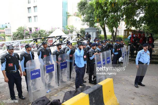 Pakistan security forces take security measures around the Election Commission of Pakistan building as members of Pakistani opposition parties' led...