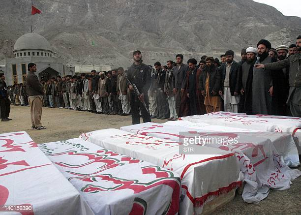 Pakistan Shiite Muslims offer prayers during a funeral for community members killed in an ambush in the northern town of Gilgit on February 29, 2012....