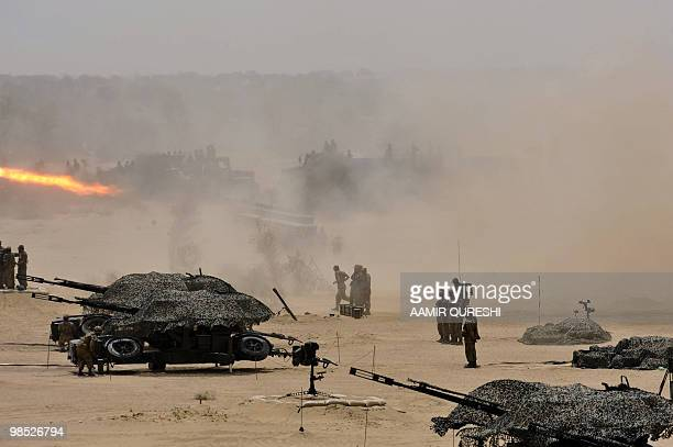 "Pakistan soldiers use weaponry to hit their targets as they take part in a military exercise in Bahawalpur on April 18, 2010. The ""Azm-e-Nau-3""..."