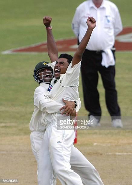Pakistan spin bowler Danish Kaneria celebrates with Asim Kamal the dismissal of West Indies batsman Brian Lara caught by wicket-keeper Kamran Akmal...