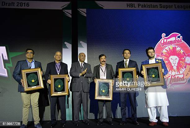 Pakistan Super League chairman Najam Sethi poses with team owners during second edition of PSL draft in Dubai on October 19 2016 Pakistan's Twenty20...