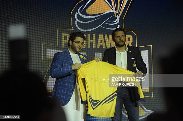 Pakistan Super League team Peshawar Zalmi captain Shahid Afridi takes team shirt during second edition of Pakistan Super League draft in Dubai on...