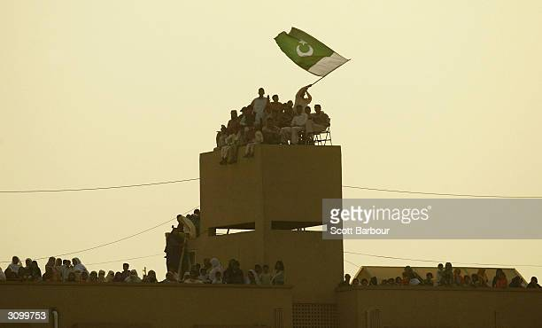 Pakistan supporters celebrate on rooftops near the ground during the second one day international match between Pakistan and India played at Pindi...
