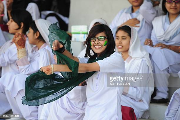 Pakistan supporters celebrate their team's victory of the second and final T20 match between the Pakistan and Bangladesh women's cricket teams at The...