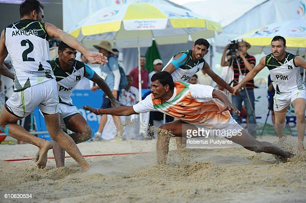 Pakistan team compete against India team during Beach Kabaddi Men's final match on day four of the 5th Asian Beach Games 2016 at Bien Dong Park Pham...