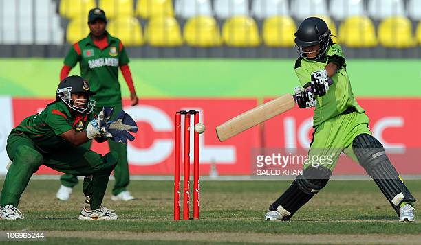 Pakistan team opening batswoman Javeria Wadood plays for a boundary as Bangladesh wicketkeeper Yesmin Boishakhi tries to catch the ball in the...