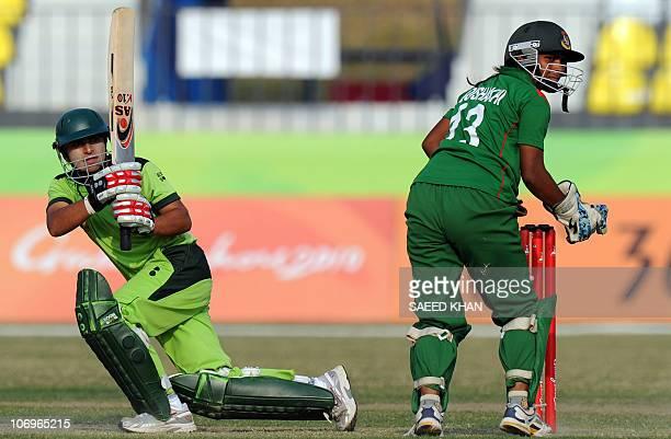 Pakistan team opening batswoman Nida Rashid plays for a boundary as Bangladesh wicketkeeper Yesmin Boishakhi looks on in the women's limited overs...