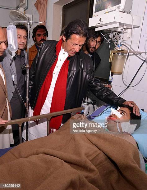Pakistan TehreekiInsaf party of cricketerturnedpolitician Imran Khan visits injured victim at a hospital following a Taliban assault on an armyrun...