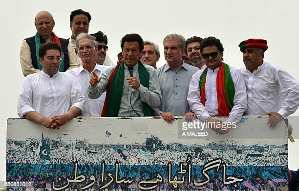 Pakistan Tehrik-e-Insaf chairman Imran Khan addresses participants at the start of the Tehrik-e-Ehtesab rally in Peshawar on August 7, 2016. The...