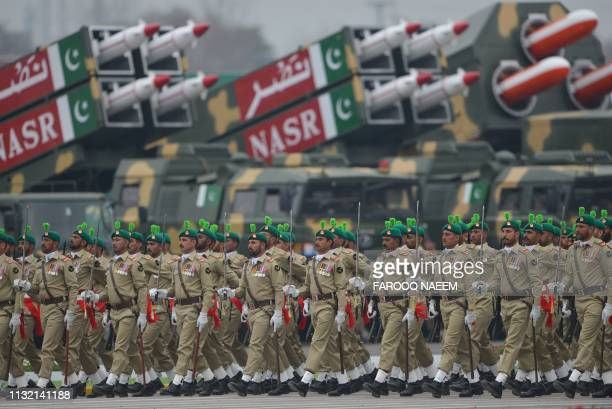 Pakistan troops march during the Pakistan Day parade in Islamabad on March 23 2019 Pakistan National Day commemorates the passing of the Lahore...
