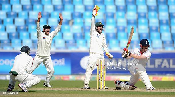 Pakistan wicketkeeper Adnan Akmal and Mohammad Hafeez successfully appeal for the wicket of Eoin Morgan of England during the first Test match...