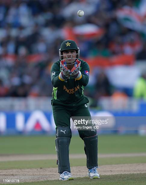 Pakistan wicketkeeper Kamran Akmal collects a throw during the ICC Champions Trophy group A match between India and Pakistan at Edgbaston on June 15...