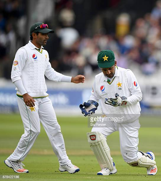 Pakistan wicketkeeper Sarfraz Ahmed reacts after he had dropped Alastair Cook off bowler Mohammad Amir during day two of the 1st Investec Test match...