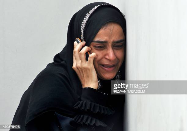 A Pakistan woman mourns at the morgue the death of a relative who was found inside the premises of a coldstorage cargo facility at the Jinnah...