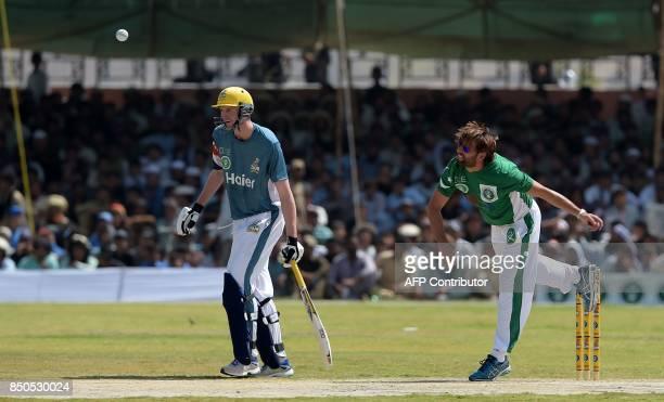 Pakistan XI bowler Shahid Afridi delivers a ball next to UK Media XI batsman during a T20 cricket match between Pakistan XI and UK Media XI at the...