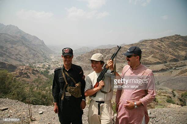 CONTENT] PakistanAfghanistan Pashtun tribal region of North West Frontier Province of Pakistan and the Khyber Rifles security guard's loaded AK47...