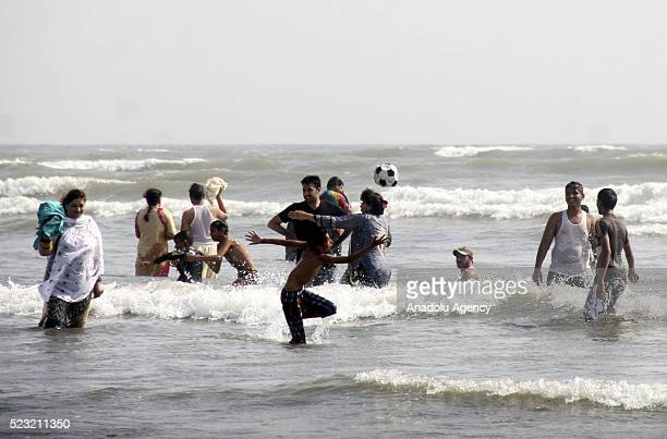 People cool off at the Clifton beach during a heat wave in Karachi Pakistan on April 22 2016