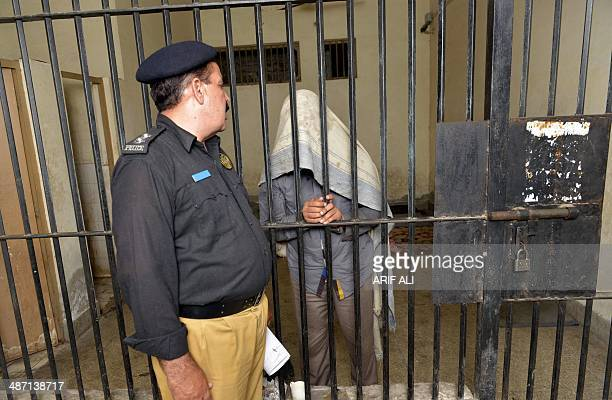 PakistancrimehomosexualityFOCUS by Issam AHMED This photo taken on April 27 2014 shows a Pakistani police officer speaking to a suspect in connection...