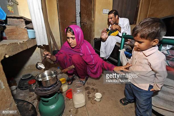 PakistaneconomyinflationfoodfuelFEATURE by Danny Kemp Hijra wife of Pakistani government employee Fakharuz Zaman makes tea in their oneroom house in...