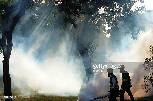 PakistanhealthdengueFOCUS by Masroor Gilani In this photograph taken on September 28 2011 Pakistani health workers fumigate against dengue carrying...