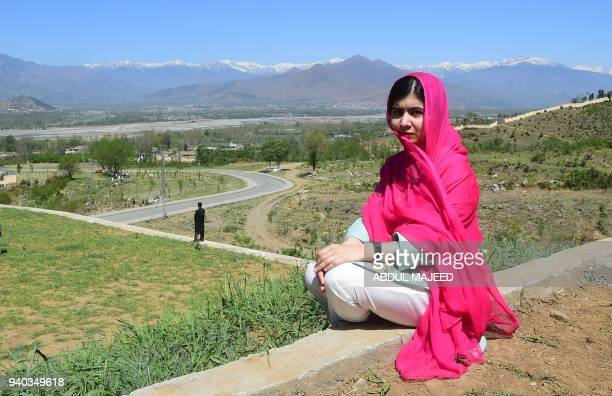 TOPSHOT Pakistani activist and Nobel Peace Prize laureate Malala Yousafzai poses for a photograph at allboys Swat Cadet College Guli Bagh during her...