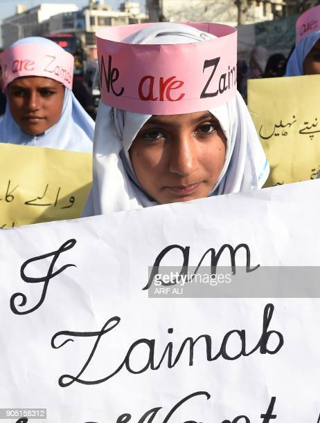 A Pakistani activist from JamaateIslami Islamist party carries placards during a protest after a child was raped and murdered in Lahore on January 15...