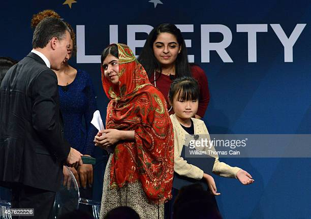 Pakistani activist Malala Yousafzai 17 years old recipient of the 2014 Liberty Medal is greeted by Jeffrey Rosen President and CEO of the National...