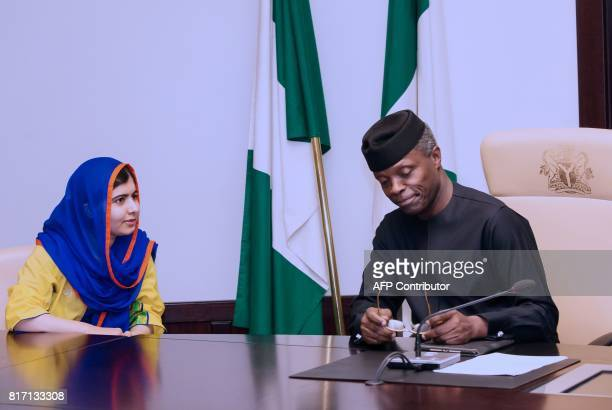 Pakistani activist Malala Yousafzai speaks with Nigeria's Acting President Yemi Osinbajo during her courtesy visit to the presidency in Abuja on July...