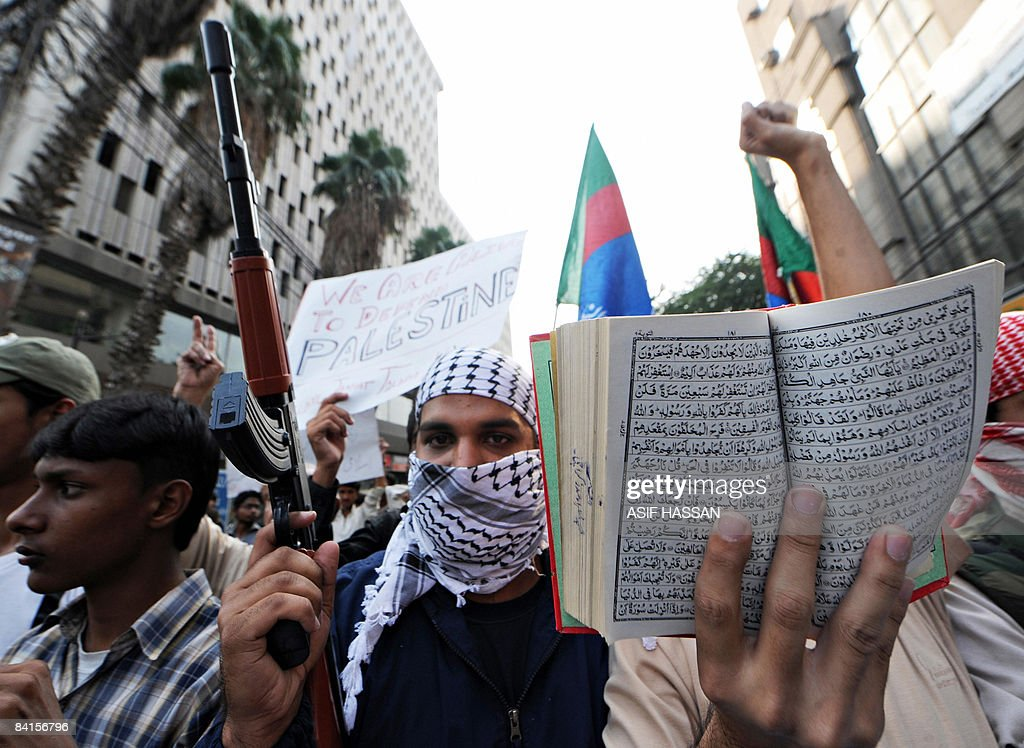 A Pakistani activist of Islami Jamiat-e-Tulaba (IJT), a student wing of fundamentalist party Jamaat-i-Islami (JI), carries a toy gun and a copy of the Koran during a protest rally in Karachi on December 31, 2008, against Israeli military attacks on Gaza. Amid worldwide protests against Israeli military action in Gaza, the Israeli security cabinet on December 31 had rejected international proposals for a truce in its offensive on Hamas in Gaza, a senior government official said. AFP PHOTO/ Asif HASSAN