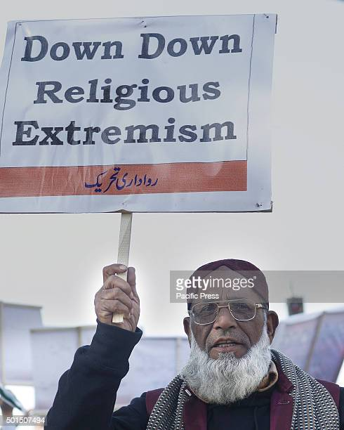Pakistani activists carries placard during a rally to pay tribute to the victims of the Peshawar school massacre of December 16 the deadliest terror...