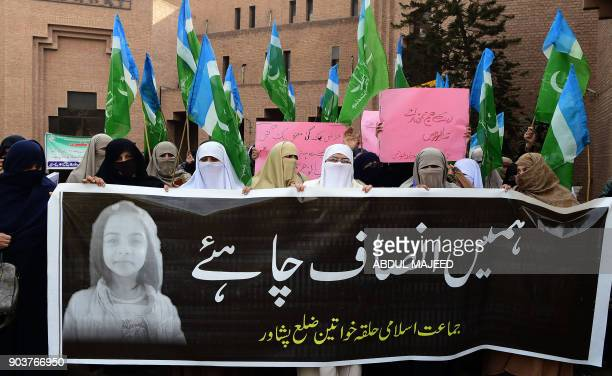 Pakistani activists from JamaateIslami Islamist party carry a banner reading 'we want justice' during a protest against the rape and murder of a...
