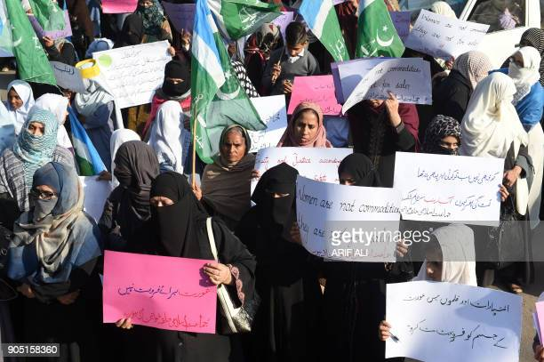 Pakistani activists from JamaateIslami Islamist party carry placards during a protest after a child was raped and murdered in Lahore on January 15...